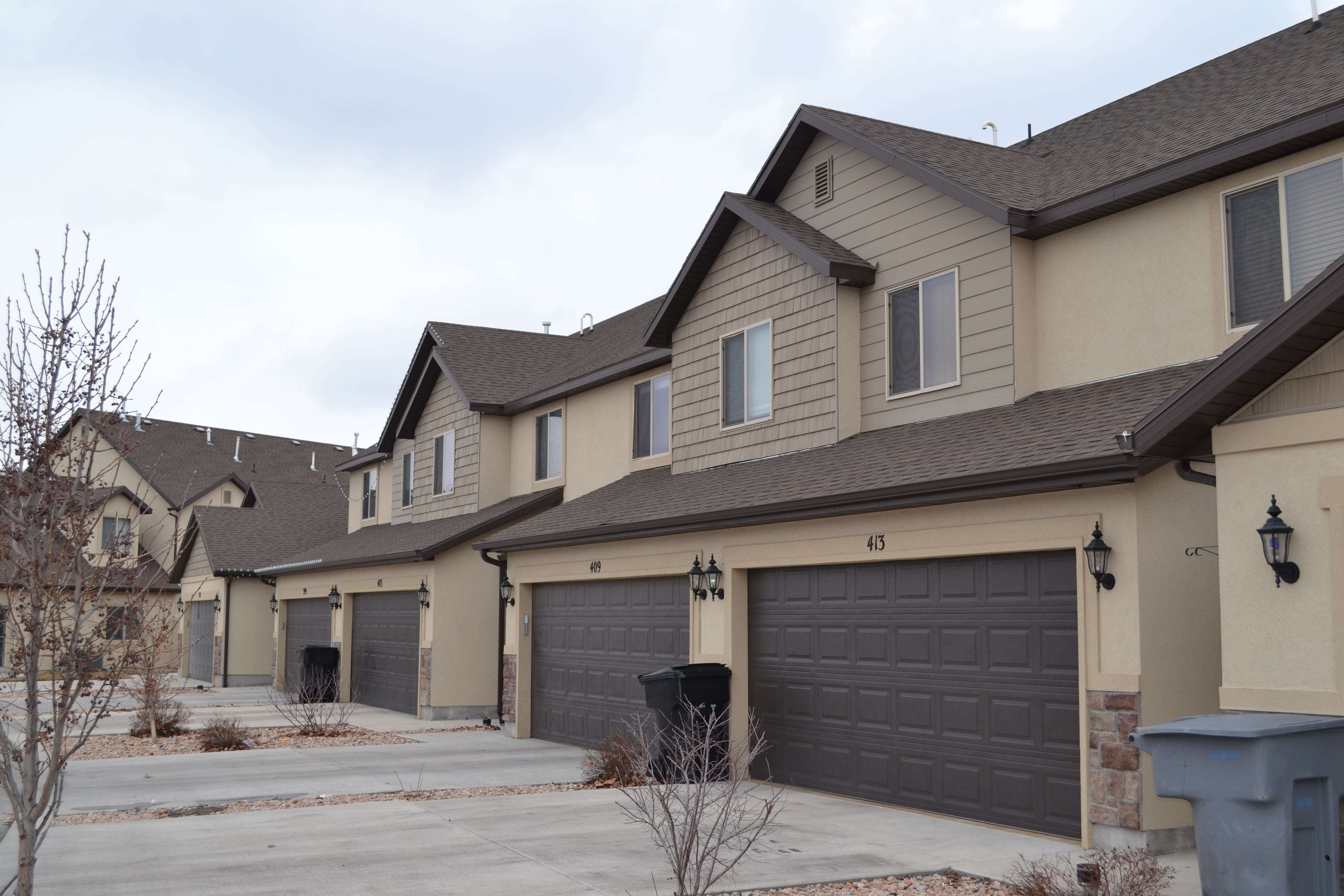 Spanish trails townhomes for Production home builders